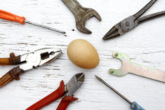 Saying if it ain`t broke, don`t fix it metaphor with whole egg Stock Images