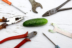 Saying if it ain`t broke, don`t fix it metaphor with whole cucum Stock Image