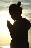 Saying Prayers. Overlooking the ocean Royalty Free Stock Photography