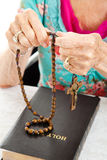 Saying the Rosary Royalty Free Stock Image