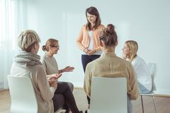 Saying something about yourself. Young women has to say something about herself Stock Images