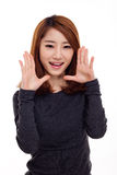 Saying young asian woman. Isolated on white background royalty free stock photography