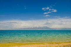 Sayram Lake by the meadow, on the plateau Royalty Free Stock Photo