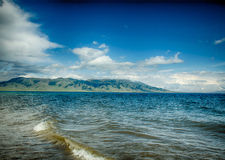 Sayram Lake by the meadow, on the plateau Stock Photo