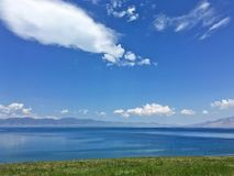 Sayram Sailimu Lake Blue sky. Sayram Lake Sàilǐmù hú is located in the Bortala Prefecture near the Tian Shan Mountains, Xinjiang, China. In the royalty free stock images