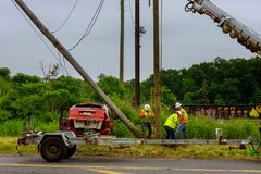 Sayreville NJ USA - Jujy 02, 2018: Replacing the electric pillar after a car accident crashes into electricity pole royalty free stock photography