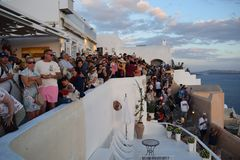 Crowded place in Oia, just for the miracle of the sunset stock photos
