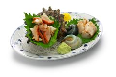 Sazae horned turban shell sashimi. Traditional japanese seafood dish stock photos