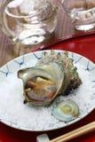 Sazae no tsuboyaki, grilled horned turban shell Royalty Free Stock Photography