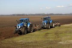 Sbarco coltivato trattore di agricoltura Immagine Stock