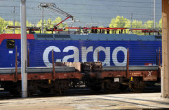 SBB Cargo locomotive. And goods train transporting iron bars in Domodossola Railway station, Piedmont, Italy Stock Images