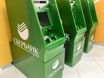 ATM cash mashines in airport. SBERBANK ATM electronic cash mashines in Sheremetyevo Airport, Moscow, Russia royalty free stock images