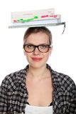 Sblonde student girl balancing books on her head Royalty Free Stock Image