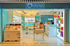 Sbocco dei prodotti di cura di bellezza del nido, Hong Kong Immagine Stock