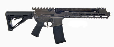 SBR AR15 with suppresed 6 inch barrel and collapsed stock. Black chrome SBR AR15 with suppressed 6` barrel, collapsed stock, 30rd magazine to catch the brass Royalty Free Stock Photos
