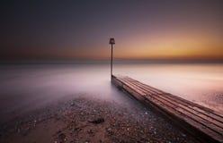Scène côtière de coucher du soleil Photographie stock libre de droits