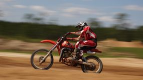 Scène d'action de motocross - tache floue de mouvement Photo stock