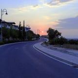 Scène de coucher du soleil avec la route Photos stock