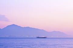 Scène de coucher du soleil le long de la côte Images libres de droits