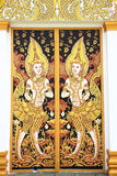 Scène de cygnes peinte sur un temple. Photos stock