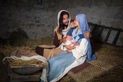 Scène de nativité dans une grange Images libres de droits