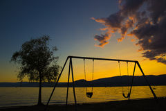 Scène de plage de coucher du soleil Image libre de droits
