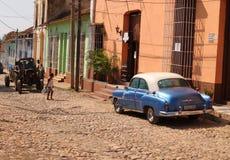 Scène de rue au Trinidad, Cuba Photos stock