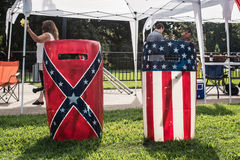 SC Confederate Flag Rally. Columbia, South Carolina - July, 10, 2017: Riot shields painted with the Confederate Flag and the American flag sit in the grass on Royalty Free Stock Photo