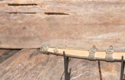Scabbard sword steel blade samurai easel ancient on old wooden surface floor with copy space.  Royalty Free Stock Photos