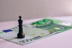 Scacchi e soldi Fotografia Stock