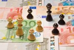 Scacchi finanziari Immagini Stock