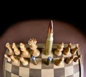 Scacchiera e pallottole Immagine Stock
