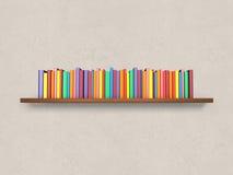 Scaffale per libri con i libri variopinti sulla parete Immagine Stock Libera da Diritti