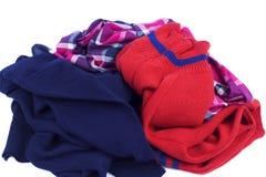Scaffali dell'abbigliamento sparsi Fotografia Stock Libera da Diritti