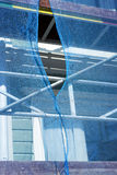 Scafflolding draped in blue debris netting Stock Photography