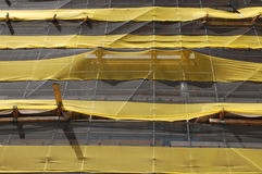Scaffold. A yellow covered scaffold on a construction site Stock Photography