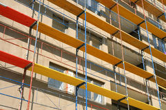 Scaffold. Of various colors on construction site Stock Photo