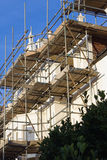 Scaffold. The scaffold. Renovation work in progress Royalty Free Stock Images