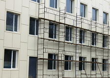 Scaffold against the wall. And some windows Stock Photography