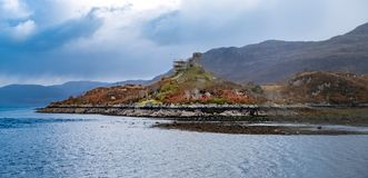 Scaffold around `Caisteal Maol`, Gaelic: Caisteal, `Castle`, Maol, `bare` , a ruined castle located near the harbour of stock photo