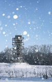 Scaffold around the water tower in field in front of forest in s Royalty Free Stock Photos