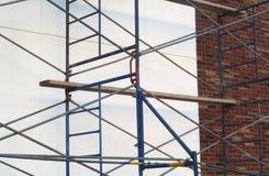 Scaffold construction site brick and concrete wall renovation. Construction wall brick and concrete scaffold renovation structure Stock Image