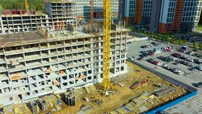 Scaffold between floors and interior partitions in construction building aerial view. Employees working on construction