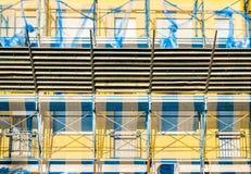 Scaffold on house facade. Stock Photo