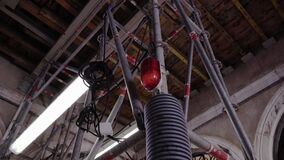Scaffold with lamps stands inside building at reconstruction