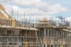 Scaffold platforms on new housing estate home buildings under co Stock Photos