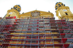Scaffold for restoration of an old building. Scaffolding for restoration of a church in Odeonsplatz, Munich, Germany Stock Photo