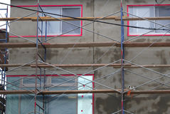 Scaffold structure concrete wall facade house exterior repair cement Royalty Free Stock Images