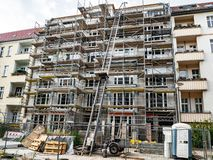 Scaffold surrounding new building completion construction. Scaffold surrounding new building completion of construction stock photo