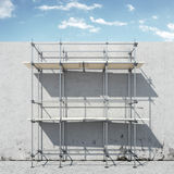 Scaffold on wall in front of sky Stock Images